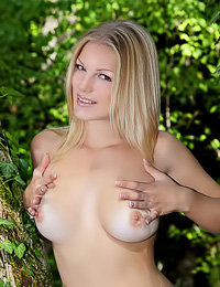 Cristal A takes her sexy white dress in the woods and teases us with her amazing big jugs.
