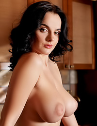 Lana I takes her slutt red skirt before the camera and shows us her amazing round breasts.