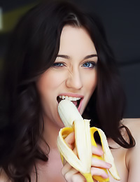 Zsanett Tormay takes all of her clothes in front of the camera and seductively eats a banana.