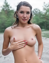 Semmi A takes her sexy dress in the woods and teases us with her big round firm breasts.