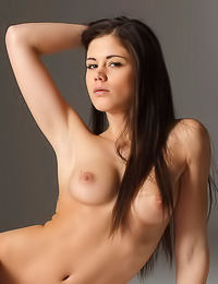 Caprice A takes her sexy white shirt in front of the camer and shows us her perky boobs.