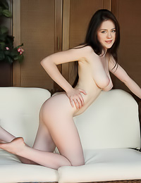 Annis A: Pale dark haired chick takes her sexy lingerie off flaunting her round booty and her bald cunt.