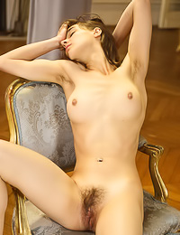 Leonda A: Endearing brunette cutie poses naked showing her big natural hooters and her hairy snatch.