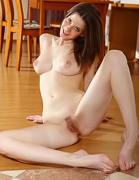 Delicate dark haired floozy takes her clothes off exposing her big tits and her trimmed muff.
