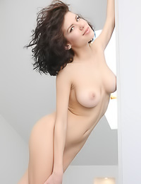Passionate dark haired gal shows off her delicate round boobs and her big juicy booty.
