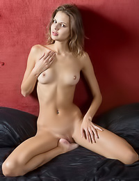 Sandra Lauver: Tempting blonde babe takes her sexy dress off revealing her round tits and her shaved cunt.