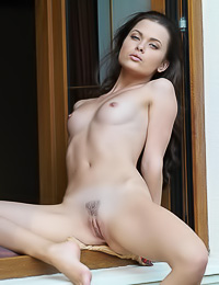 Lusty dark haired floozy spreads her yummy legs to reveal her sweet little trimmed pussy.