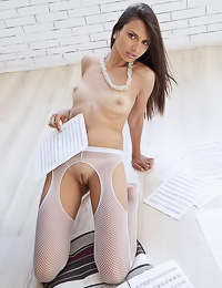 Natania A: Mesmeric dark haired gal poses in sexy white stockings flaunting her delicate shaved pussy.
