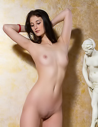Ravishing brunette floozy slips out of white lingerie and flaunts her superb slim body.