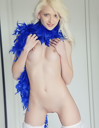 Slim pale blondy poses in thigh-high stockings flaunting her perky tits and her bald snatch.