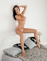 Slim raven haired gal poses in black lingerie before taking it off to expose her stunning body.