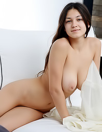 Divine raven haired gal takes her clothes off showing her large boobs and her hairy muff.