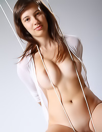 Gea A: Alluring brunette sweety poses naked showing off her big natural tits and her bald pussy.
