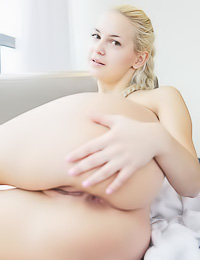 Tender blonde cutie takes her clothes off revealing her tiny boobies and her shaved snatch.