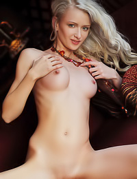Nika N: Tender blonde cutie enjoys showing off her delicious long legs and her sweet shaved snatch.