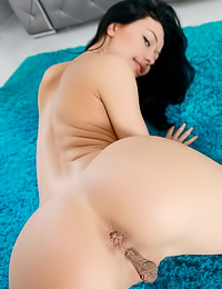 Yummy dark haired gal with big knockers shows off her shaved pussy and her round butt.