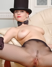Fishnet stockings, high heels, black gloves and red lipstick, this babe needs nothing more.