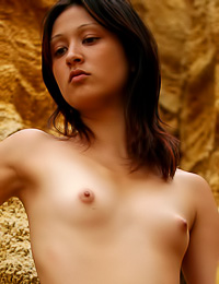 Jacinta A is taking a trip through the caves and is doing that wearing nothing but her skin.