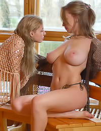 Big breasted teen gals Julia Z and Vika Z take off their clothes and amke out passionately.