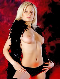 Blond and seductive girl Milana A has got some brand new leather boots and wears nothing else.