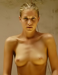 Her golden hair and golden skin look amazing when she stretches naked on golden sheets.