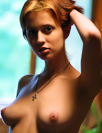 Short hairred teen gal Hilary A takes off her clothes and teases us with her fabulous breasts.