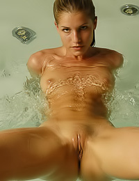 Lusty blonde Iveta B takes a hot bath in the hot tub in front of the camera and shows her ass.