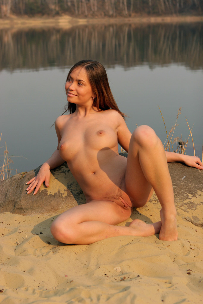 Busty Teen Gal Julia Aa Poses Naked On The Beach And Rubs