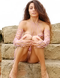 Passionate lady Maiya A strips fully naked by the ocean and shows every inch of her hot body.