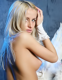 Attractive blonde angel Ada C takes off her thongs and teases in little white whings.