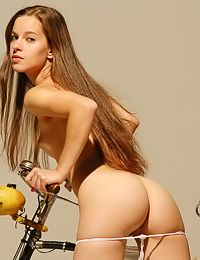 Attractive and sexy Selene B takes off her slutty white thongs and then rides her new bike.