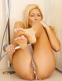 Beautiful blonde angel Adriana B showes her hot curvy body and plays with her huge big breasts.
