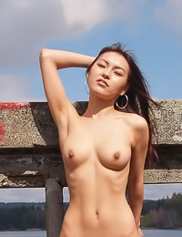 Smiling Asian cuttie Agnes A walks fully nude on the opean road and flashes her perky boobs.