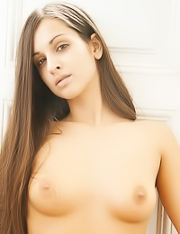 Ennie A: Good looking brunette model Ennie A takes off her clothes and shows her shaved cunny.