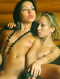 Horny lesbo girls Dasha I and Tanya L take off their clothes and make out for the camera.