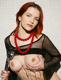 Beautiful and seductive redhead vixen Ulya I takes off her black top and shows her round jugs.