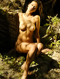 Natali D: Big breasted brunette babe Natali D strips her clothes in the woods and shows her wet muff.