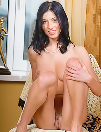 Fuckable brunette lady Katya P takes her sexy skirt off and shows us her bouncy big jugs.