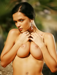 Big breasted brunette gal Jenya D takes off her clothes and shows her trimmed wet pussy.