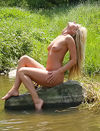 Lenka A: Very attractive blonde hottie Lenka A takes her white thongs and white slip off outdoors.