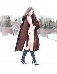 Horny teen gal Natasha S took her coat off on a winters day and flashed her perky breasts.