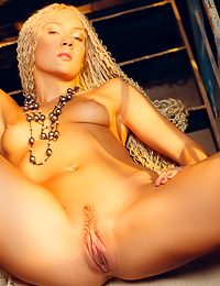 Foxy and slutty blonde girl Mazantara A stripsher white lingerie and shows us her gaping muff.