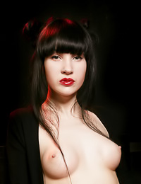 Gothic Asian babe Ditta A looks stunningly sexy with redlipstick and black stockings on.