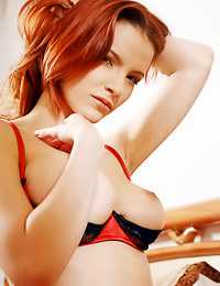 Beautiful busty redhead chick Ulya I takes off her expensive lingerie and shows her fanny.