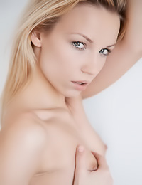 Gwyneth A: Beautiful blonde model Gwyneth A poses in her white bed naked and touches her wet cunny.