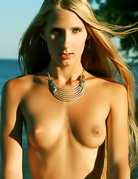 Anastasiya A: Attractive blonde vixen Anastasiya A takes off her bikini on the beach and shows her body.