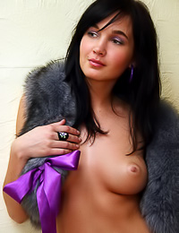 Smoking hot brunette lady Jamilya A takes off her fur coat and shows her super tight butt.