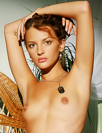 Inna Q: Lovely small breasted blonde gal Inna Q takes off her shirt and teases us in small stockings.
