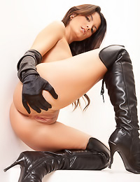 Bitchy brunette babe Amandine A teases us with her fantastic body in slutty high black boots.