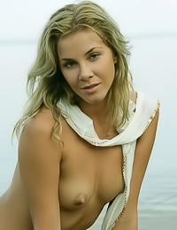 Kateryna A: Beautiful blonde lady Kateryna A swims in the ocean in her wet white shirt and shows her tits.